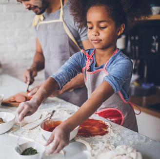 Little girl baking with her father